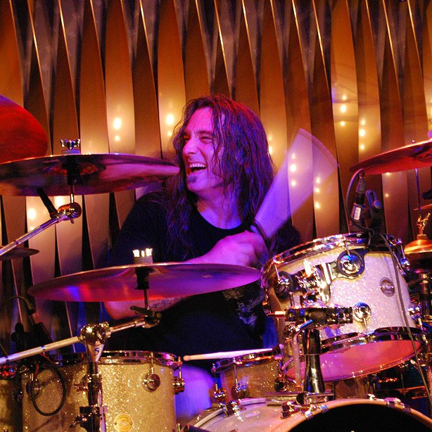 Who helped ex-Pearl Jam drummer in the 90s?